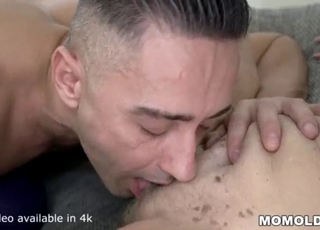 GILF in red lingerie fucks a young man