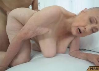 A busty old lady is enjoying his fat boner