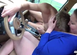 Chubby brunette is sucking in the car