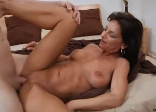 Busty brunette gives a passionate blowjob