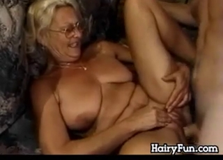Busty GILF gets fucked in the cowgirl pose