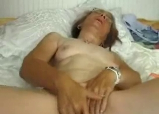Mature slowly plays with her wet crack