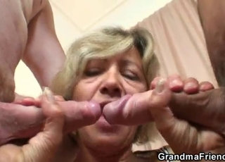 Two studs are fucking a horny mature