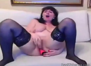 Busty brunette stimulates her little hole