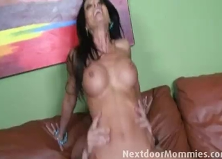Slender busty brunette jumps on a dick