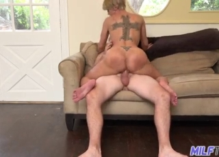 Angelic MILF is sucking down on the knees