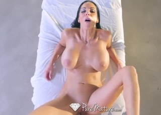 An oiled massage for a big-boobed mature doll
